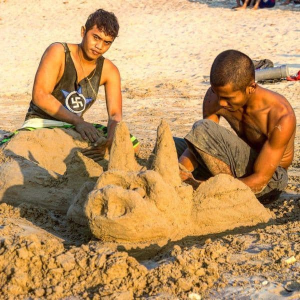 Two Balinese men creating a sand sculpture on Jimberan Beachhellip