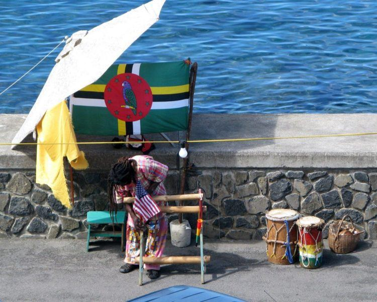 Man setting up his souvenir booth in Roseau Dominica
