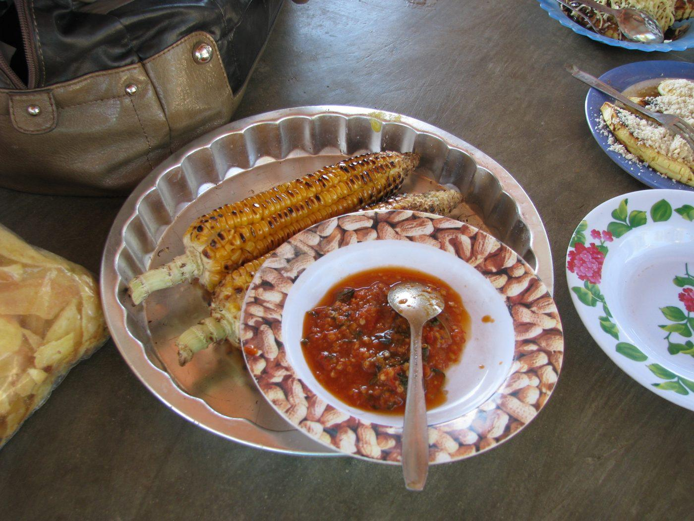 plate of grilled corn with spicy sambal