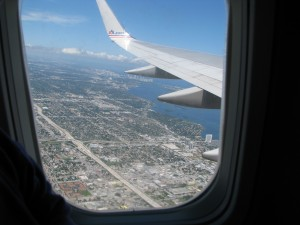 View of a wing and ground below airplane