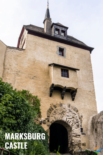 Marksburg castle gate with text overlay that says marksburg castle