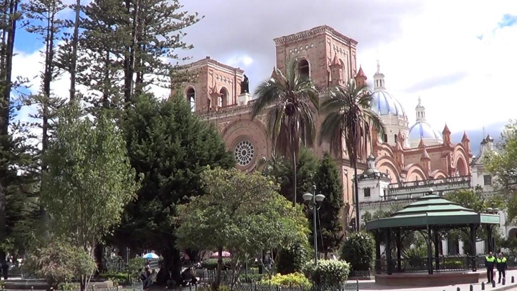 blue church domes in Parque Calderon Cuenca Ecuador