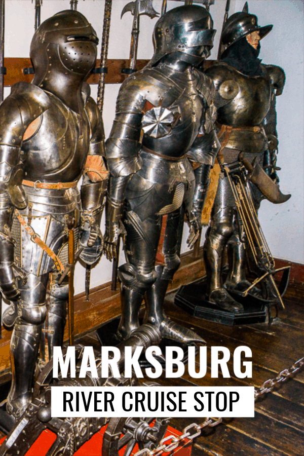 Armor on display at Marksburg Castle near Koblenz Germany. Text overlay says Marksburg River Cruise Stop