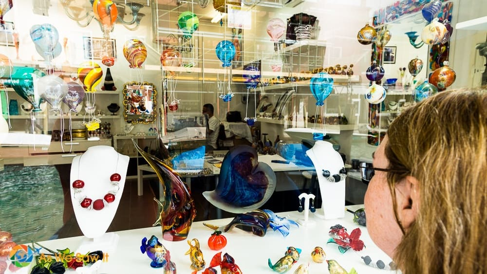 woman looking into a Murano glass shop