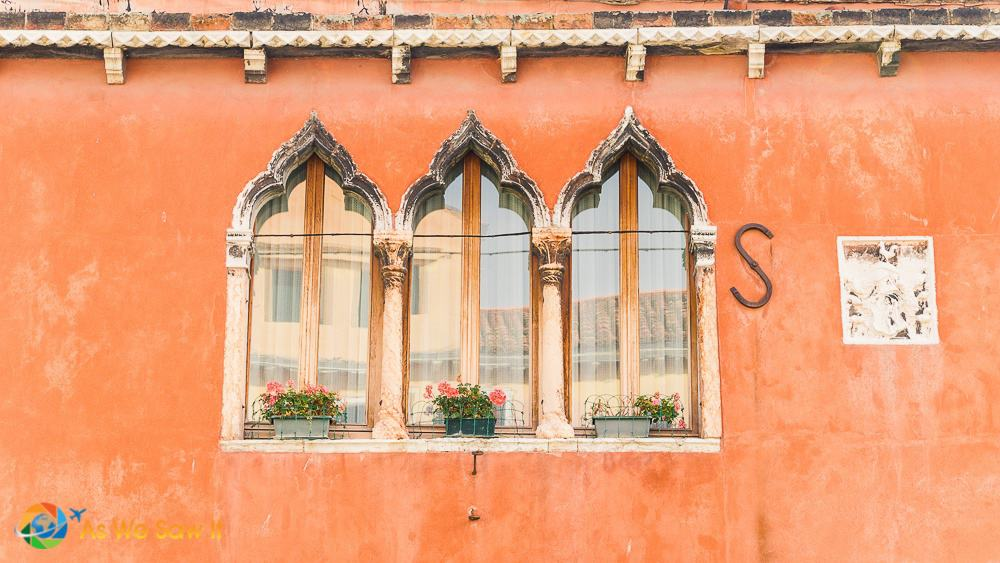 Closeup of arched windows on building in Murano, Venezia.