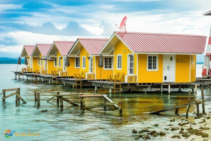 Isla Carenero Panama hotel with brilliant yellow and red cabanas
