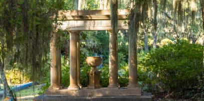 concrete Roman pillars and vase make a grave monument at Bonaventure Cemetery