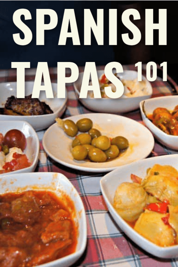 small plates of tapas on red check tablecloth, text overlay says spanish tapas 101