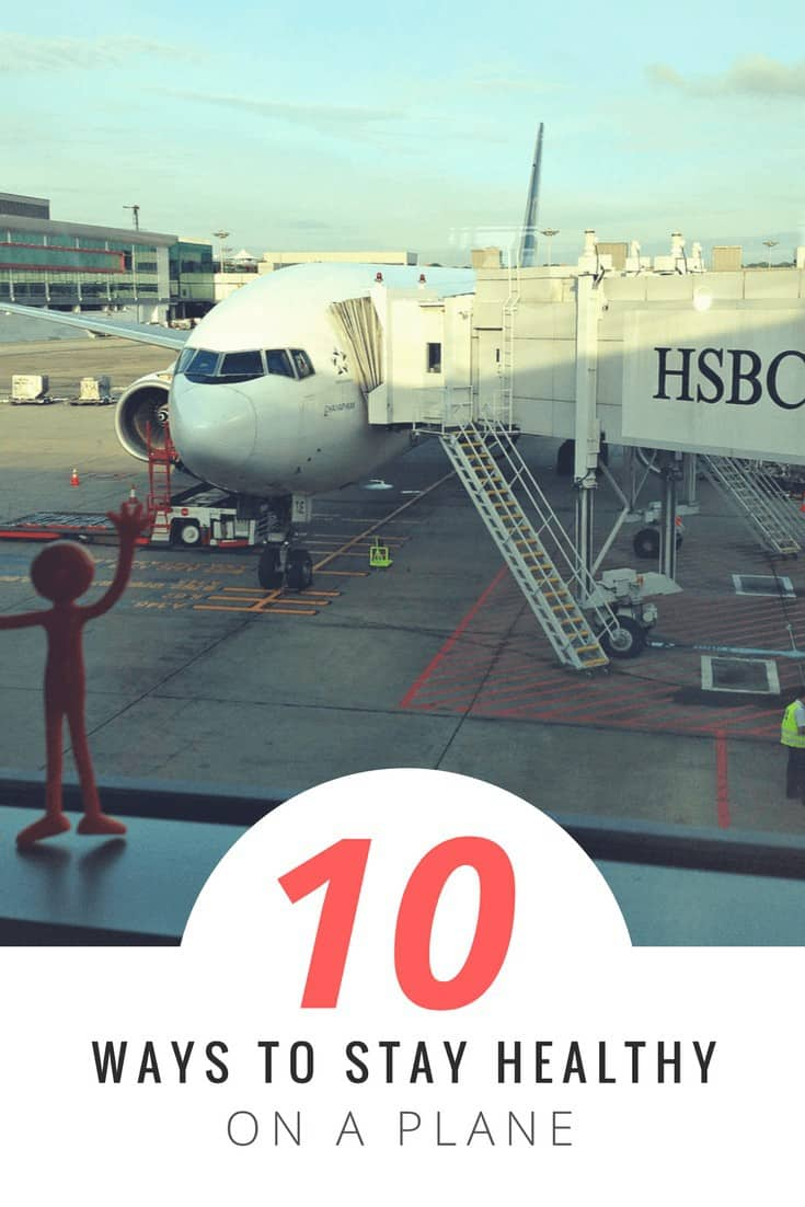 plastic figure in foreground, waving out the airport window at a plane parked and ready for passengers. Text overlay says 10 ways to stay healthy on a plane