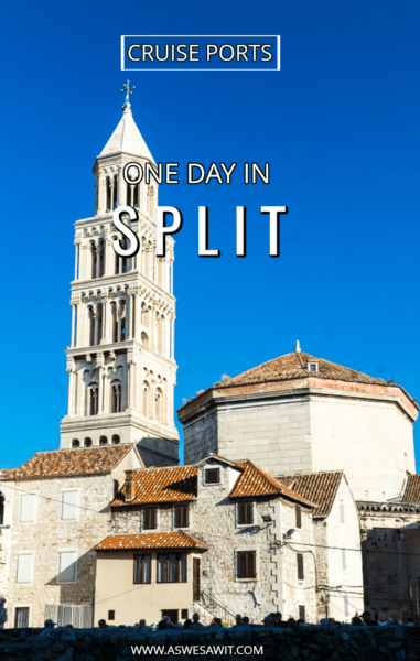 white marble tower and buildings, red tile roofs, blue sky in Split Croatia