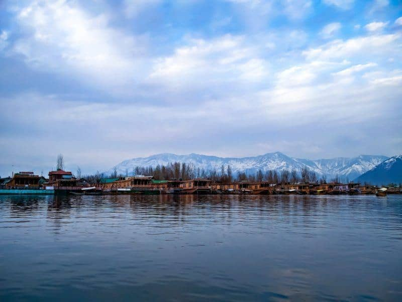 Snow capped mountains behind Dal Lake in November