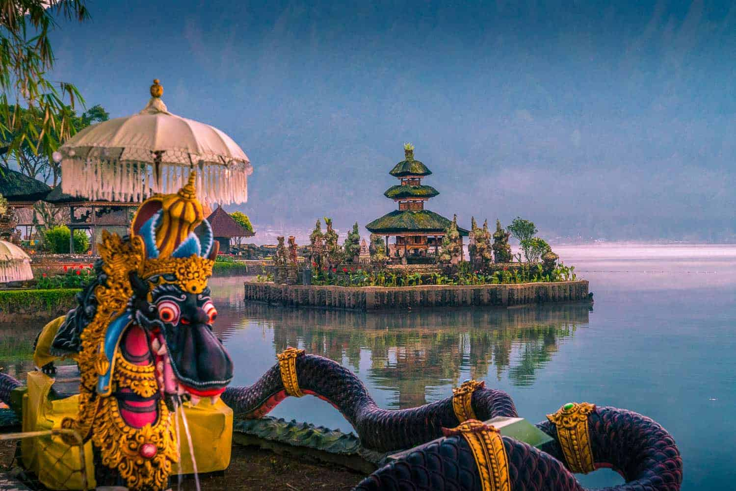 Ulun Danu Beratan in lake in Bedugul Indonesia. .Colorful statue in foreground