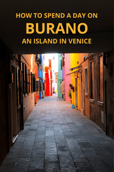 Colorful houses line a sidewalk in Burano Italy. Text Overlay says How to Spend a day in Burano an Island in Venice