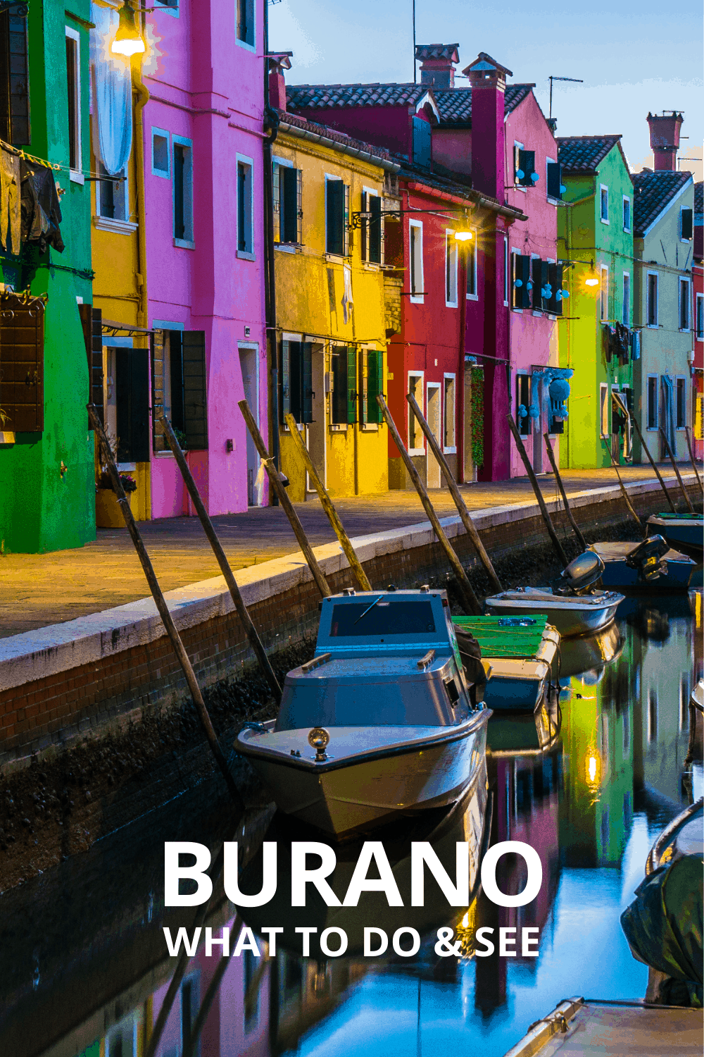 Colorful houses line a canal in Burano Italy. Text overlay says Burano What to See and Do