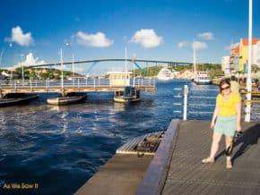View from Queen Emma pontoon bridge, looking at queen juliana, a high bridge in the backgrouind