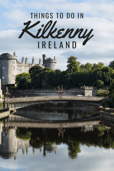 Kilkenny Castle seen from the river. Text overlay says Things to do in Kilkenny Ireland.