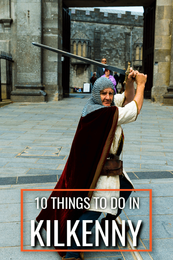 Sir Mike wields a sword in front of Kilkenny castle. Text overlay 10 Things to Do in Kilkenny