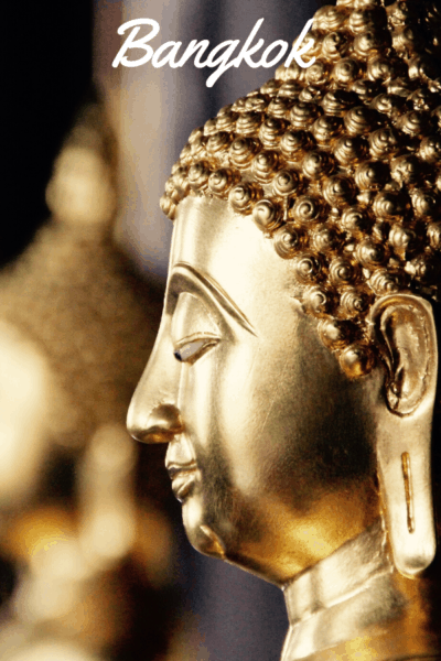 side view of a golden budha text say bangkok