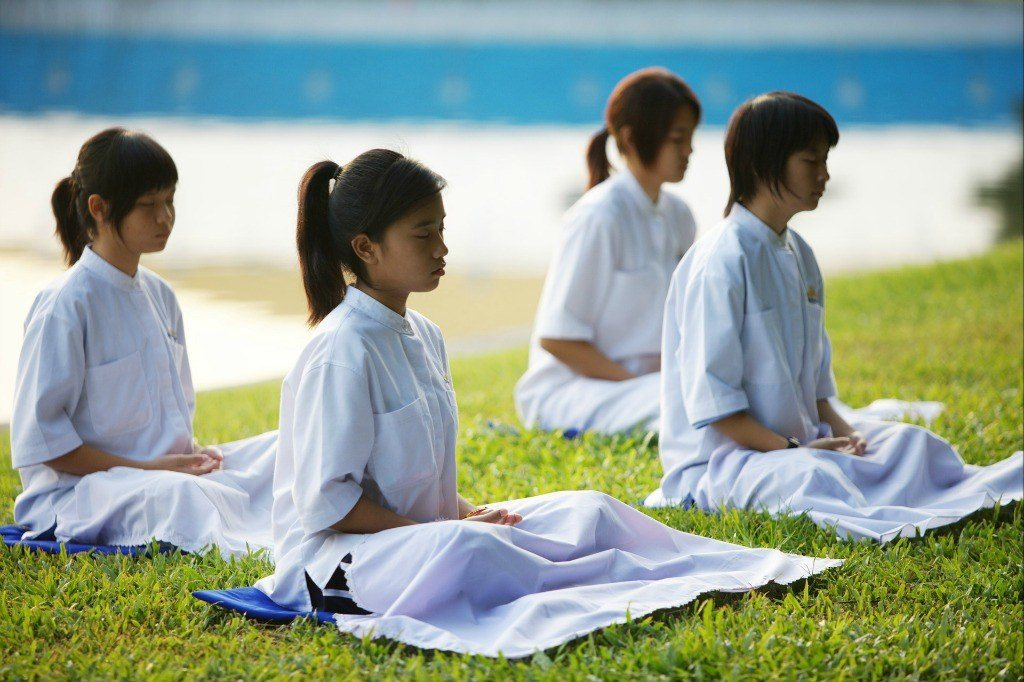 Children meditating - a unique alternative thing to do in Bangkok
