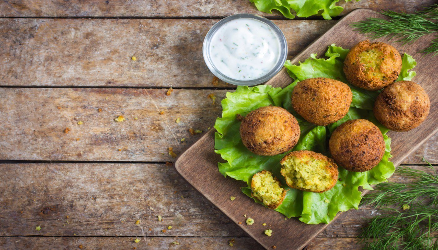 Platter of Falafel with a small side bowl of tzatziki sauce. This is a really healthy middle eastern food, made of protein-rich chickpeas