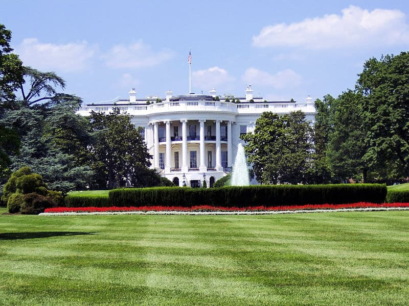 Classic view of the White House columns with fountain in front
