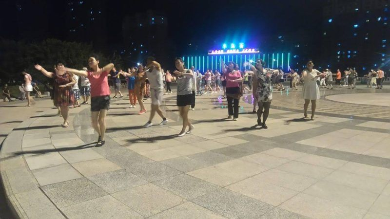 Chinese people dancing together