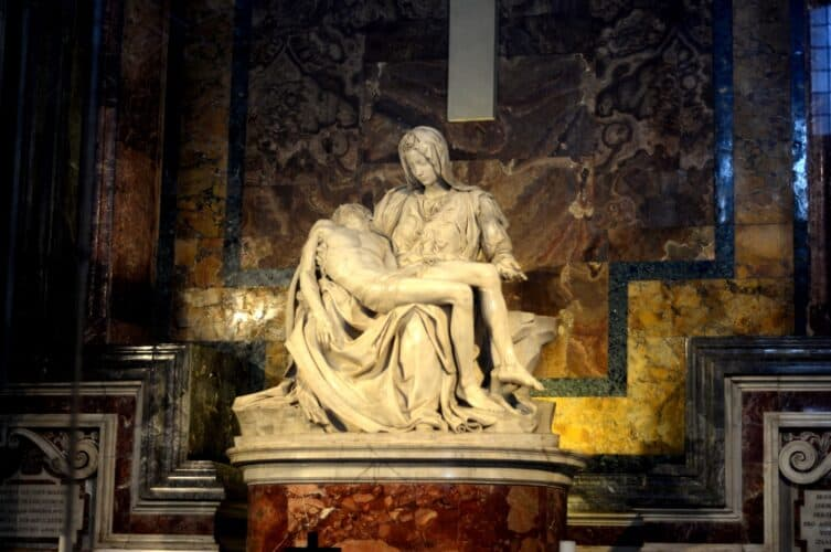 Michelangelo's Pieta statue of Mary holds the dead body of Jesus