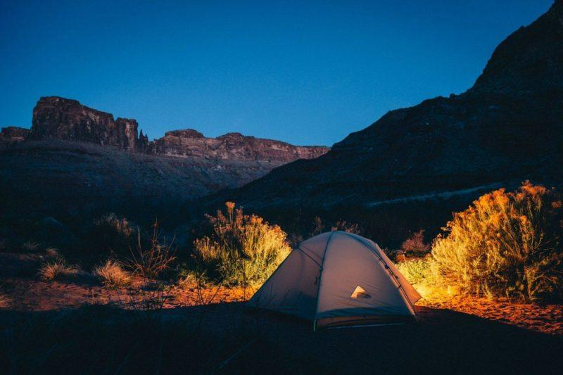 tent surrounded by mountains