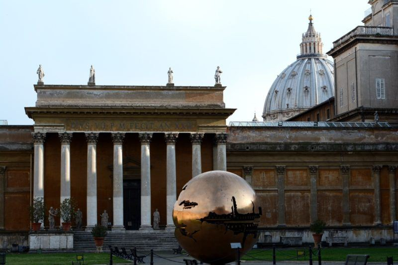 Building and bronze earth sculpture at the Vatican museums