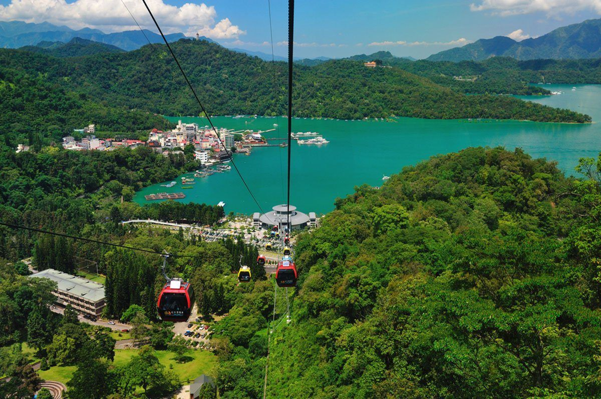 Cable cars rise from Sun Moon Lake Taiwan. Best attractions