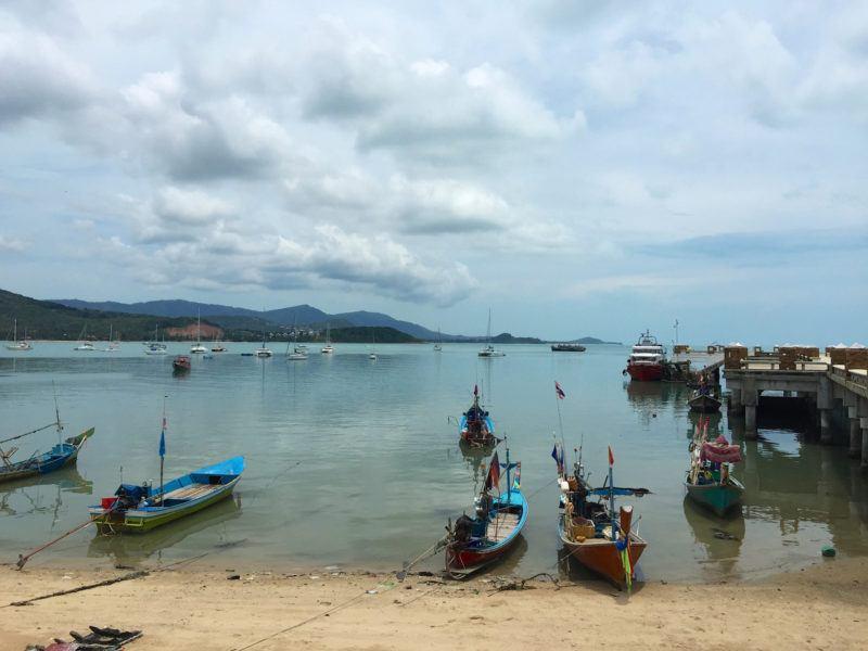 small motorboats near a pier on Big Buddha Beach Koh Samui