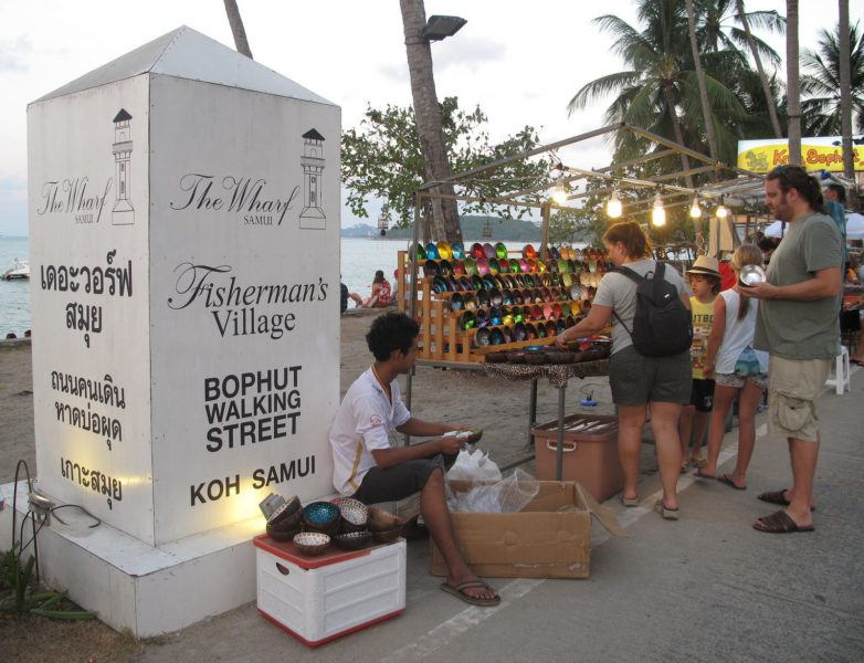 A street vendor and sign at Fisherman's Village, Bophut Beach, Koh Samui