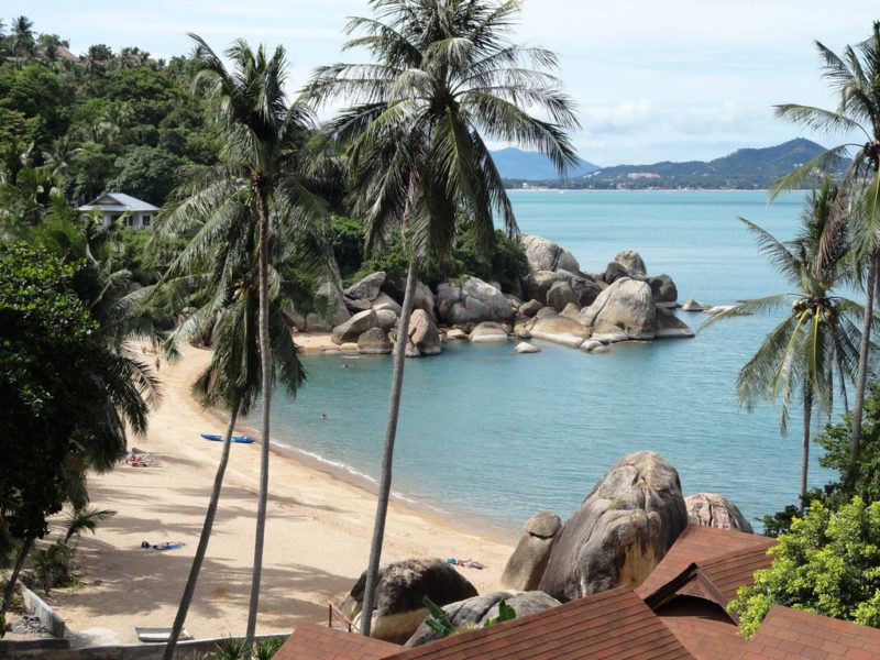 Blue waters and green hills surrounding Lamai Beach on the island of Koh Samui, Thailand