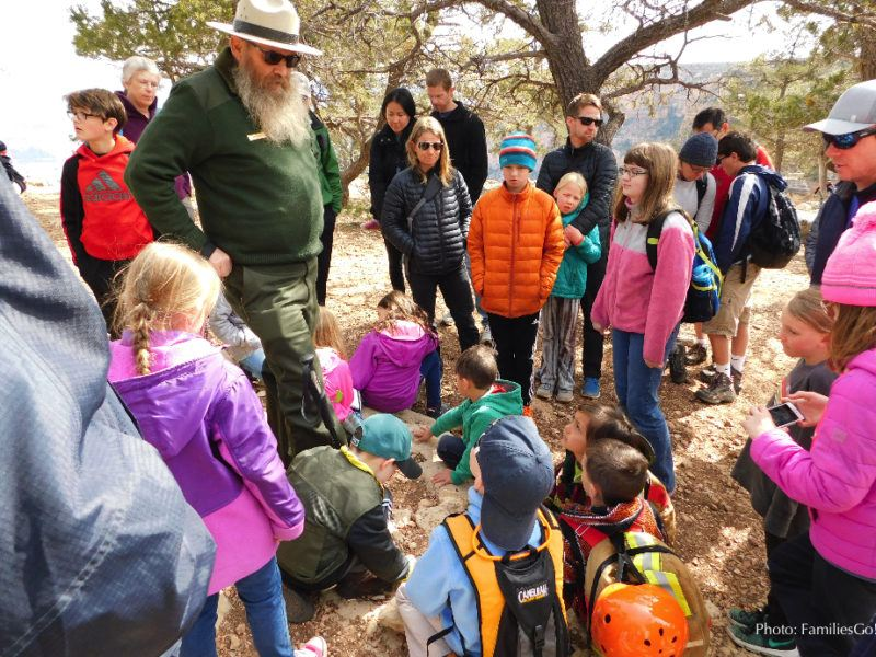 NPS Ranger talking to families, explaining all the Grand Canyon things to know.