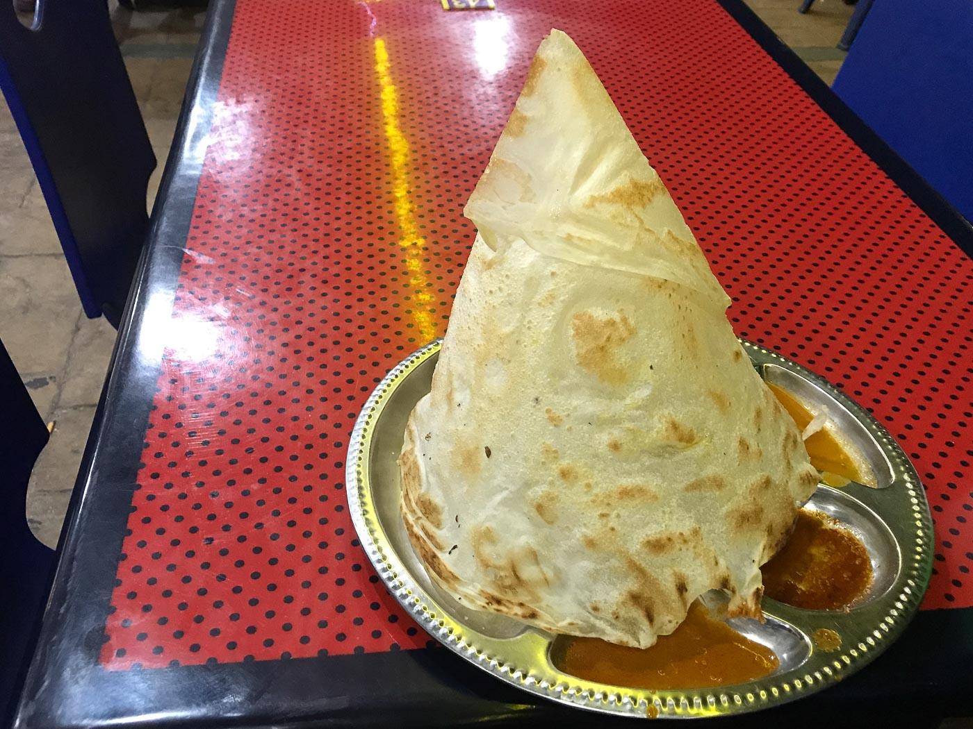 Pyramid shaped roti a top curry sauce - Roti Channi