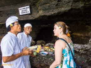 Linda talking with a priest after crossing onto Tanah Lot Temple