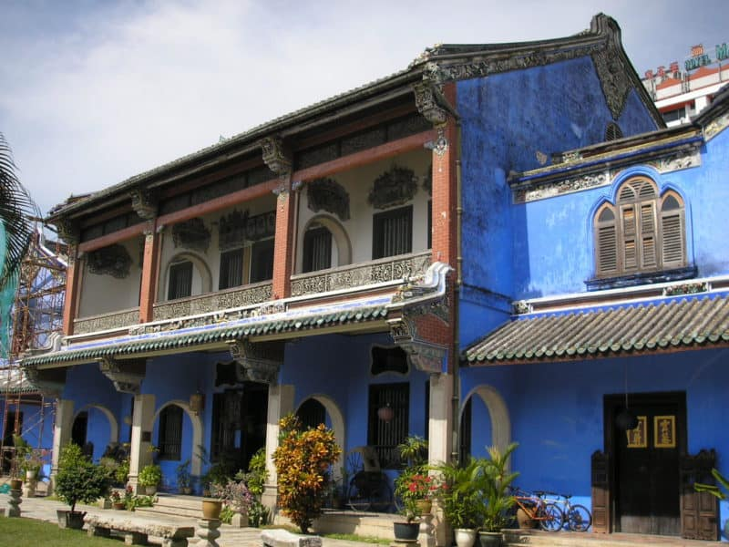 Bright blue paint on the outside of a mansion in central Penang