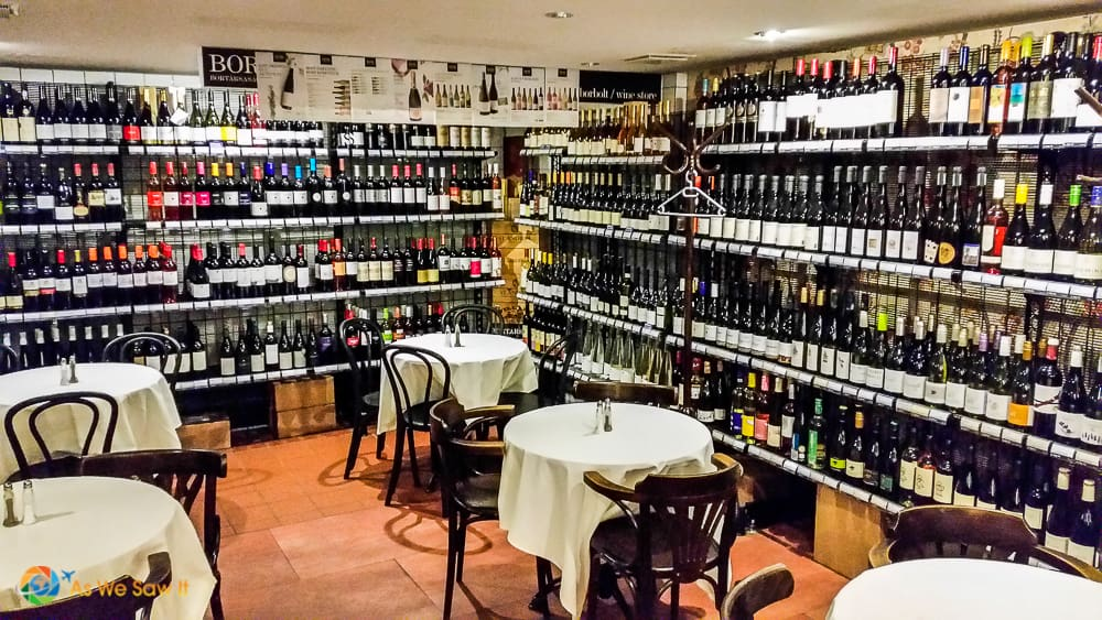 Tables and bottles of Hunarian wine in Budapest cafe