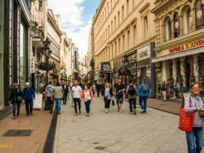 people walking on a pedestrian street and souvenir shop in Budapest