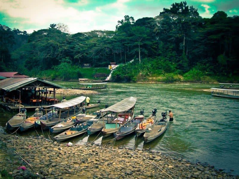 Canoes on a river in Taman Negara Malaysia