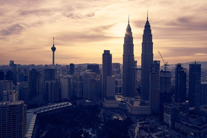 Kuala Lumpur Skyline backlit by sunset sky