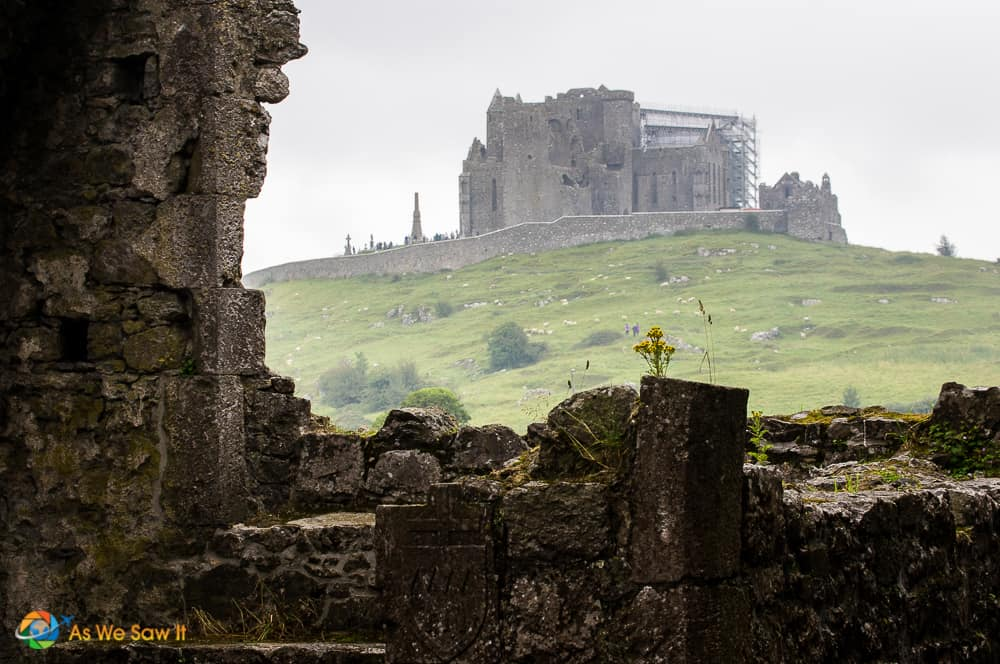 Distant view of Rock of Cashel on a hill as seen from Hore Abbey.