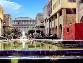 buildings surround fountains in guadalajara mexico