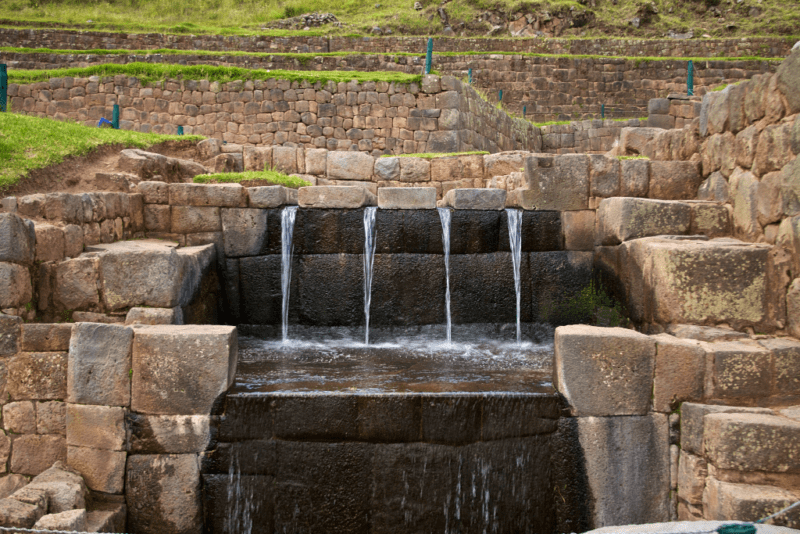 Ancient water channel spillway descends in four streams in Tipon Peru