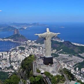 Aerial view of Rio de Janeiro from above and behind the Cristo Redentor statue.