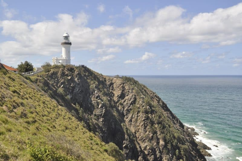 Byron Bay lighthouseon a high rocky promontory overlooking the water