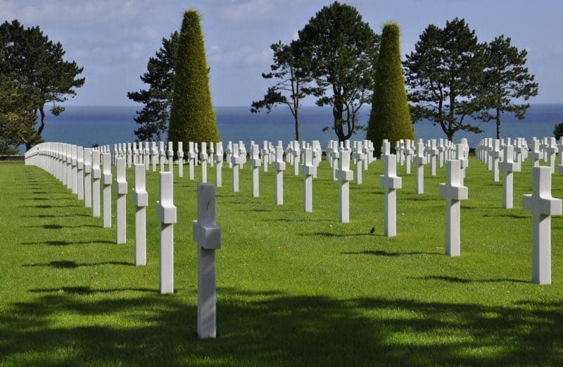 White crosses on a hill overlooking the ocean in a Normandy cemetery