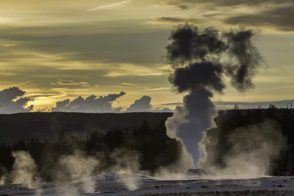 Sunset silhouettes Lion Geyser in Yellowstone