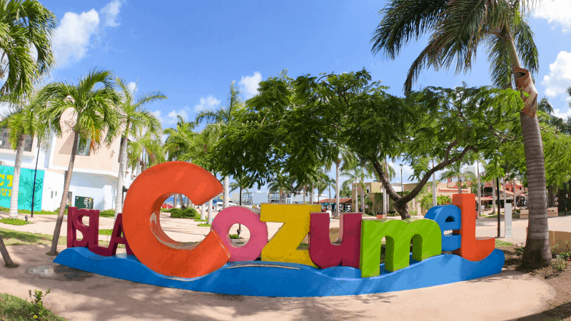 Colorful letters spell out Cozumel on the beach