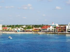 Fiew from the water of the shoreline of San Miguel, the largest city in Cozumel Mexico. Buildings line the water.
